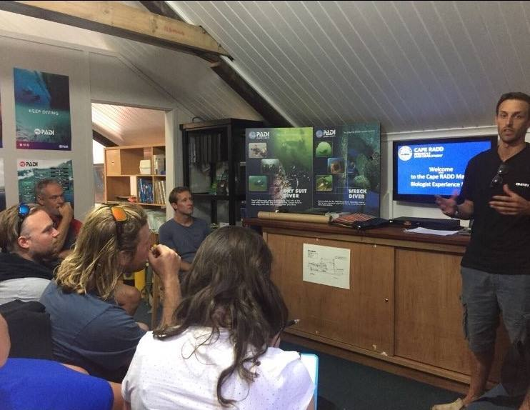 Internship students attend a lecture on biodiversity