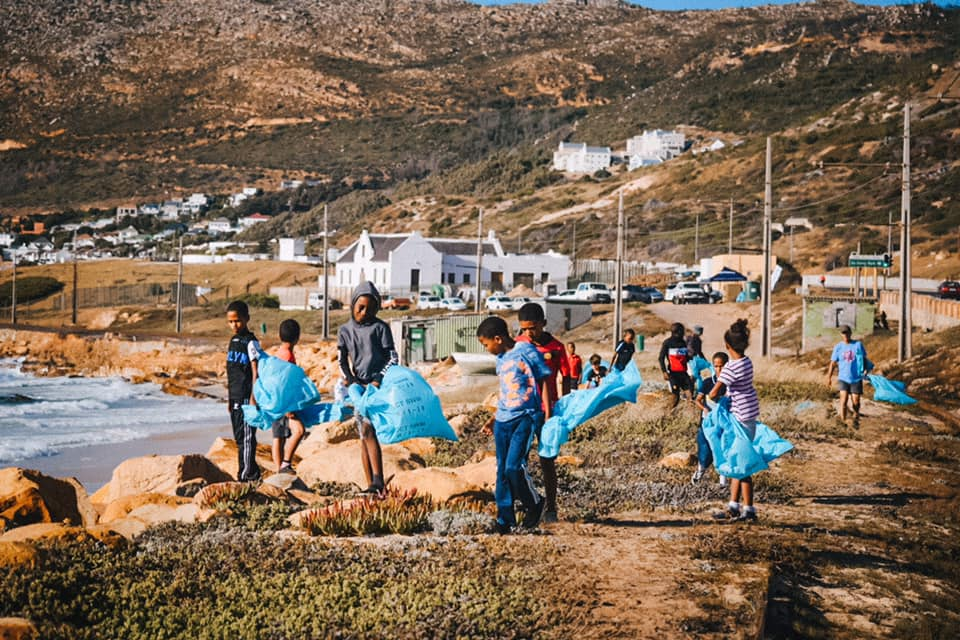 local children helping with a beach clean